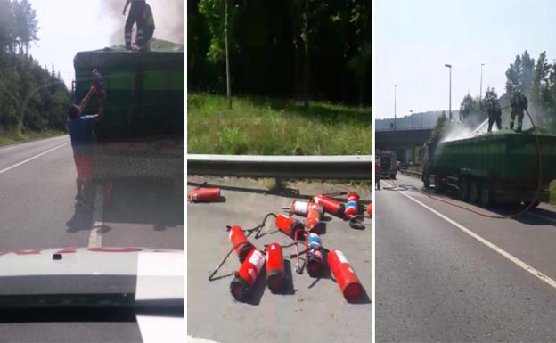 Dos operarios sofocan con extintores el incendio de un camión en el Txorierri